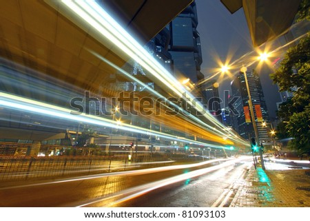 Traffic through downtown of Hong Kong at night in rainy day