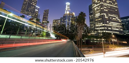 Traffic through Los Angeles financial district (long exposure leading to trail of lights) - stock photo