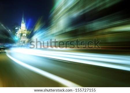 traffic through modern city at night in shanghai 2013 - stock photo