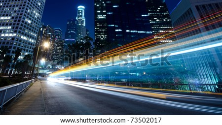 Traffic through the city (traffic seen as trails of light) - stock photo