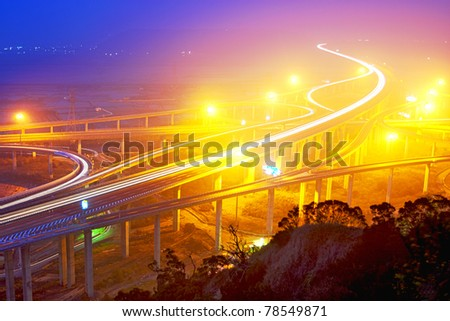 Traffic track on highway in the night in taiwan - stock photo