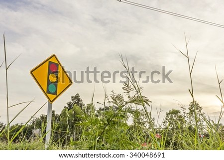 Traffic, traffic signs, traffic signal, traffic light in twilight time - stock photo