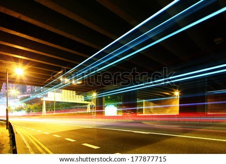 Traffic trail pass though underpass - stock photo