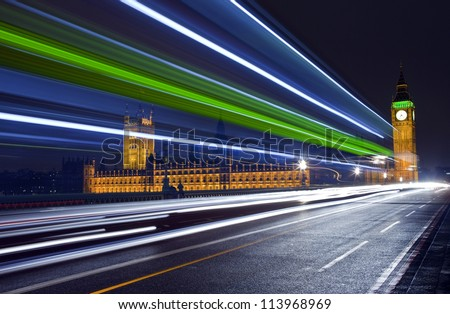 Traffic Trails Passing the Houses of Parliament - stock photo