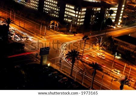 Traffic turning at a light signal at night - stock photo