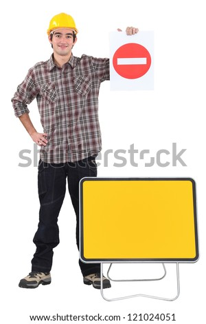 Traffic worker stood with road signs - stock photo