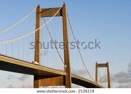 Trafic over Suspension Bridge - stock photo