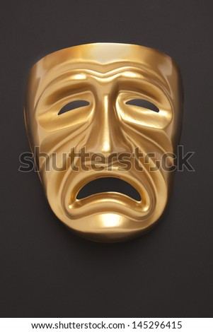 Tragedy theatrical mask on a black background - stock photo