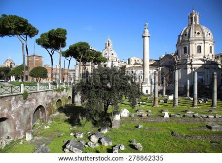 Traian column and Santa Maria di Loreto in Rome, Italy - stock photo