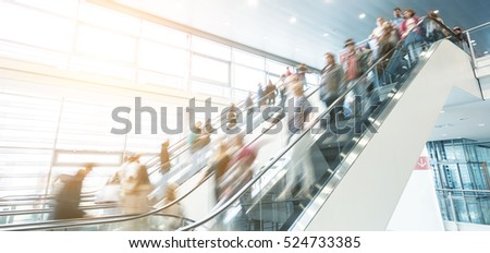 traidshow staircase with blurred people
