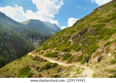 trail in the mountains. a hiker in the mountain. Climb to the top. mountaineering - stock photo
