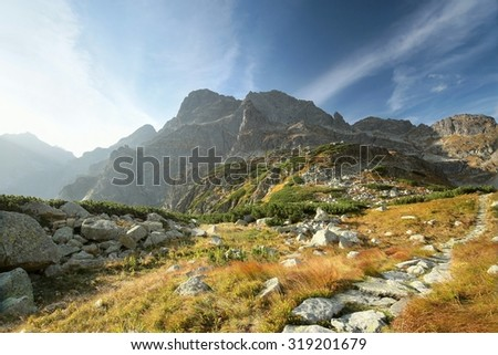 Trail in the valley leading to the peak in the Tatras. - stock photo