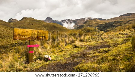 Trail mark in Cajas National Park in Ecuador, Cuenca district. Amazing landscapes of Andean highlands, with many valleys ,lakes, creeks,difficult trails covered with haze most of the time.  - stock photo