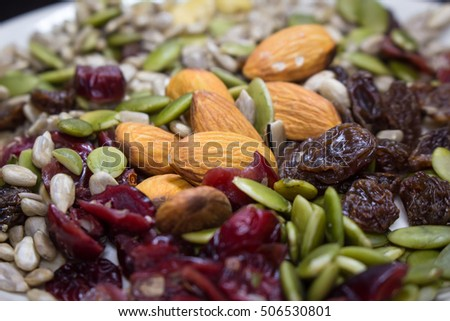 Trail mix close up on the white dish with various seed.