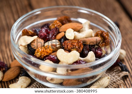 Trail Mix on wooden background (mixed dried fruits with nuts)