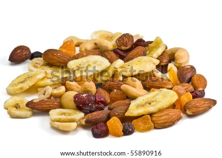 Trail mix snack with dried bananas, almond, cashew, peach, cranberries and blueberries. - stock photo