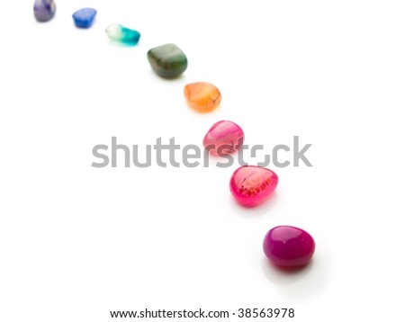 Trail of colorful natural gem stones - stock photo