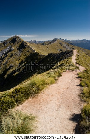 Trail on mountain ridge on kepler track, fiordland, new zealand. - stock photo