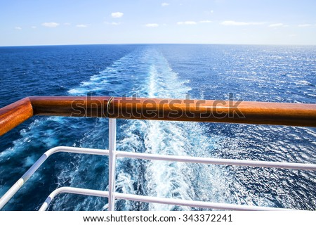 Trail on water surface behind of cruise ship - stock photo