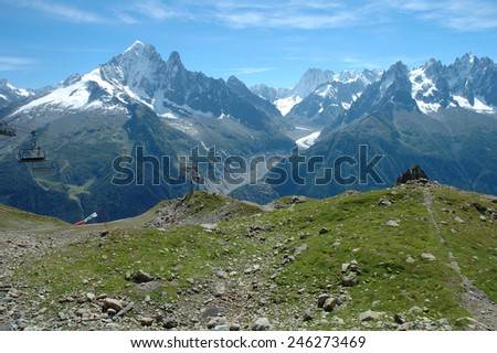 Trail, peaks and ski lift nearby Chamonix in Alps in France - stock photo