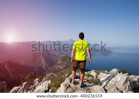 Trail running athlete man training for fitness and marathon living healthy lifestyle outside in beautiful landscape on Big Island. - stock photo
