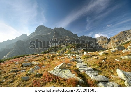 Trail through the valley in the Tatra Mountains. - stock photo