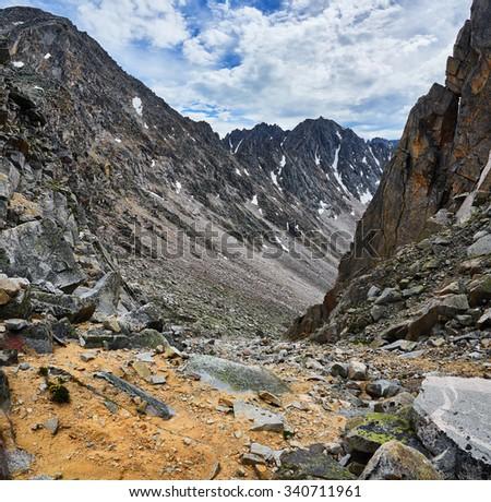 Trail to the mountain pass down the steep mountains. Eastern Sayan. The Republic of Buryatia - stock photo