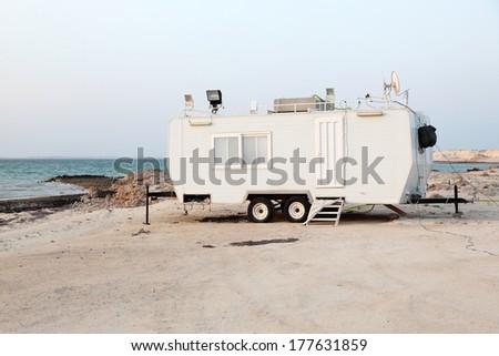 Trailer at the Arabian Gulf beach in Qatar, Middle East - stock photo