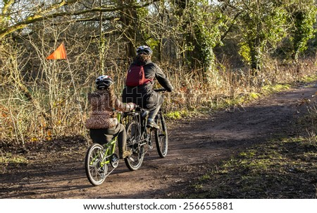 Trailer cycle attached to bicycle - stock photo