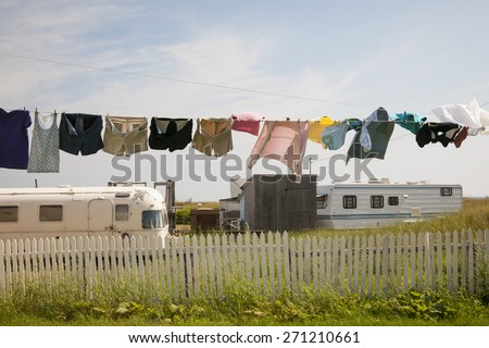 Trailer homes and laundry drying on line in North Rustico, Prince Edward Island, Canada. - stock photo