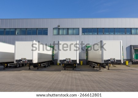 Trailers at docking stations of a distribution center waiting to be loaded - stock photo