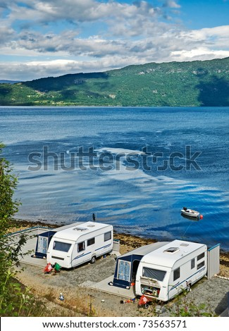 Trailers on a lakeside - stock photo