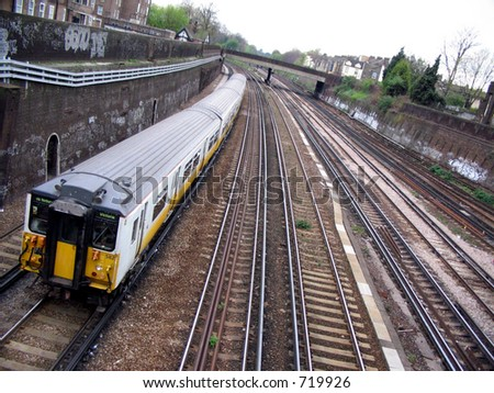 Train approaching Clapham Junction Station, London