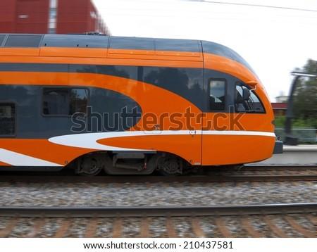 Train approaching railway station - stock photo