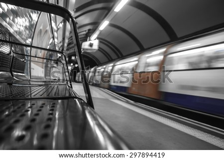 train arrival at the tube station in london - stock photo
