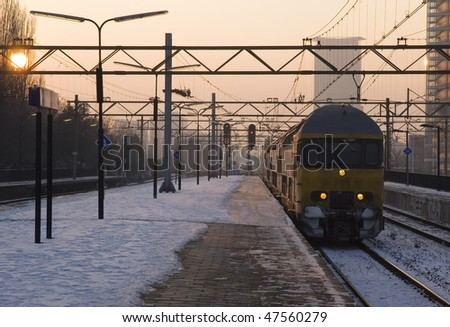 Train arriving at a trainstation - stock photo