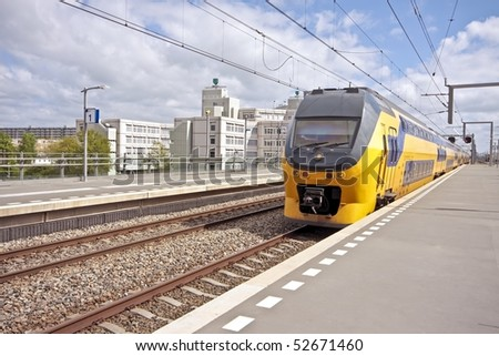 Train arriving at Bijlmerstation in Amsterdam the Netherlands - stock photo
