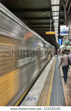 Train arriving in a Sydney Subway station. - stock photo