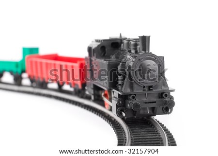 Train arriving: old toy railroad isolated - stock photo