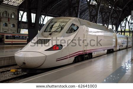 train at railway station in barcelona - stock photo