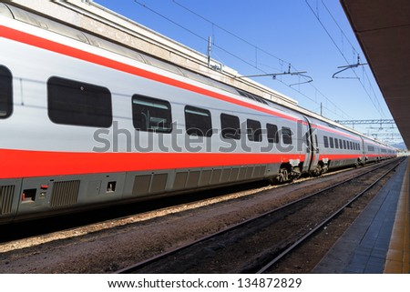 Train at the platform in railway station - stock photo