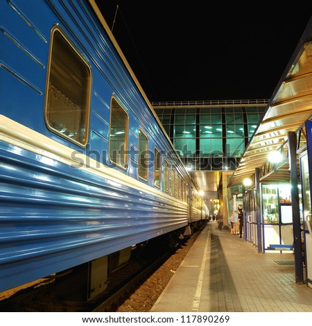train at the station at night - stock photo