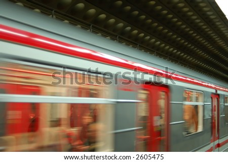 Train coming into subway station - stock photo