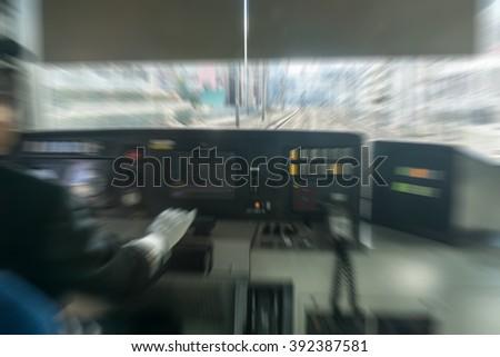 Train Conductor in blurred - stock photo