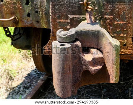 Train coupling on an old rusty train car - stock photo