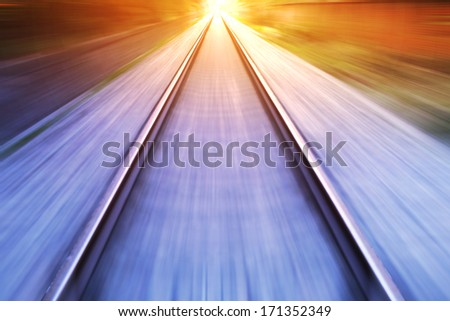 train fast run on railway track in sunny day - stock photo