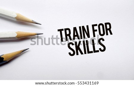 Train for skills memo written on a white background with pencils