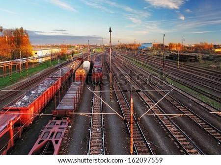 Train freight station - Cargo transportation at sunset - stock photo