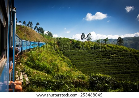 train from Nuwara Eliya to Kandy among tea plantations in the highlands of Sri Lanka - stock photo