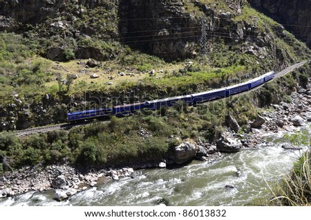 Train going to Machu Picchu from Cuzco in  the valley with Urubamba river